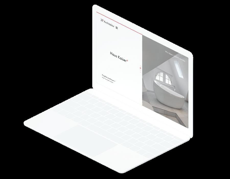 Weißes Laptop zeigt auf der Startseite der 28° Architektur Website ein Projekt der Architektur-Firma