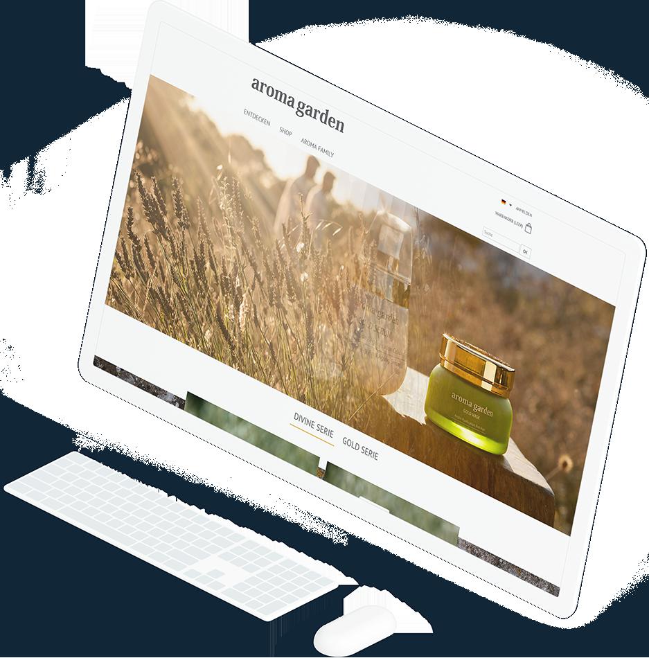 Großer, weißer Computerbildschirm zeigt auf der Startseite der Aromagarden Website den weichen Überblendeffekt des Bildwechslers in Aktion