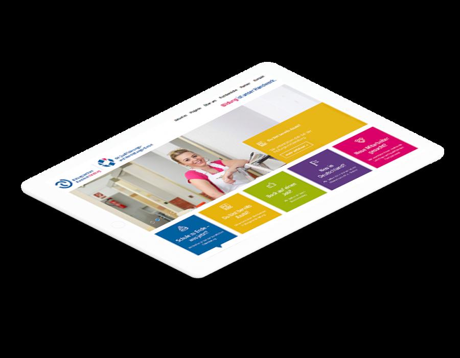 Weißes Tablet zeigt Startseite der Bildungszentrum Handwerk Duisburg Website