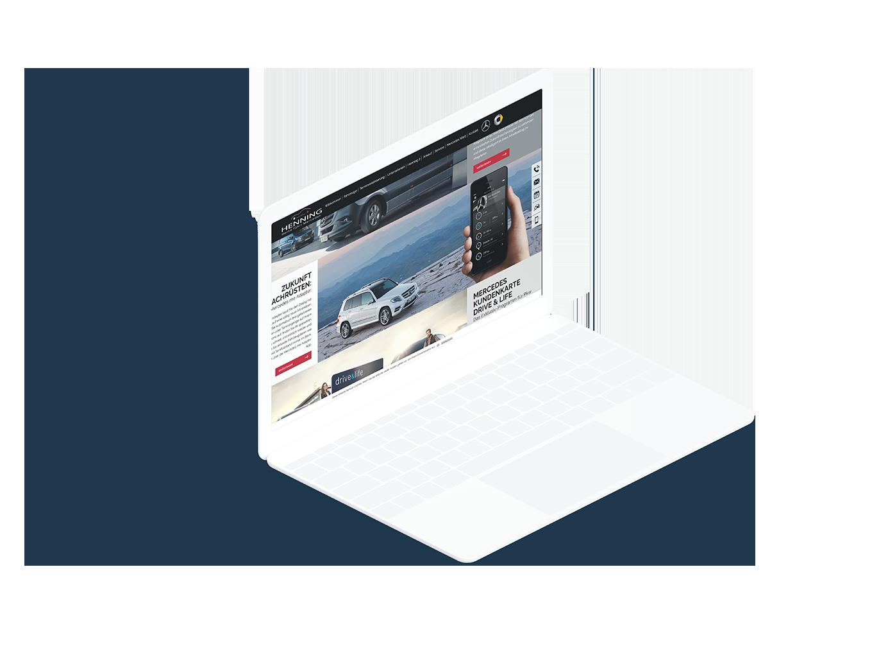 Weißes Laptop zeigt Aktuelles Unterseite der Henning-Automobil Website
