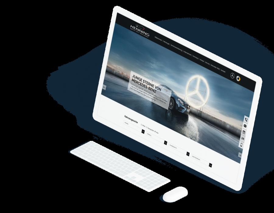 Großer weißer Computerbildschirm zeigt die Startseite der Henning-Automobil GmbH Website
