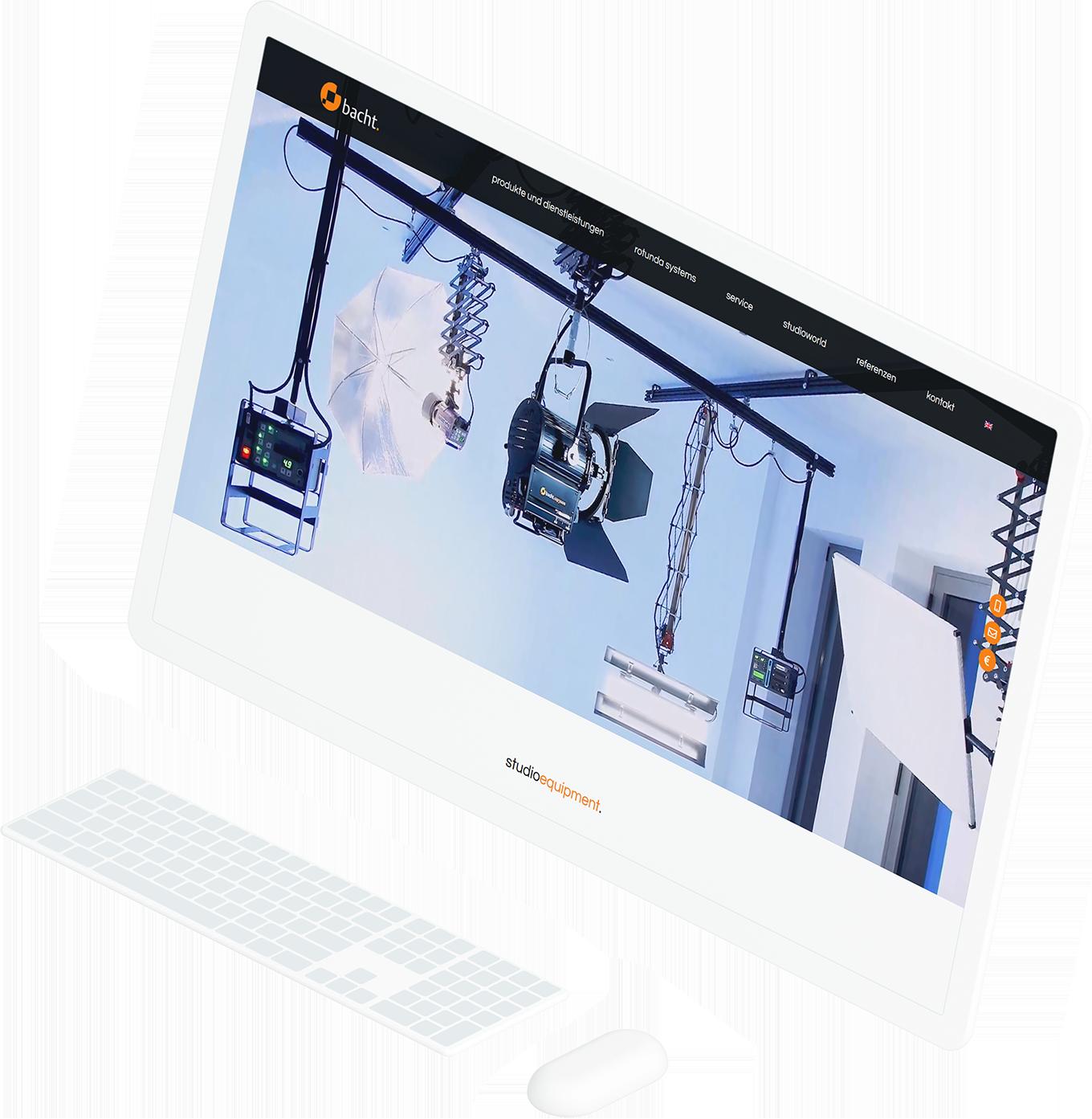 Großer, weißer Computerbildschirm, der die Startseite von bacht anzeigt