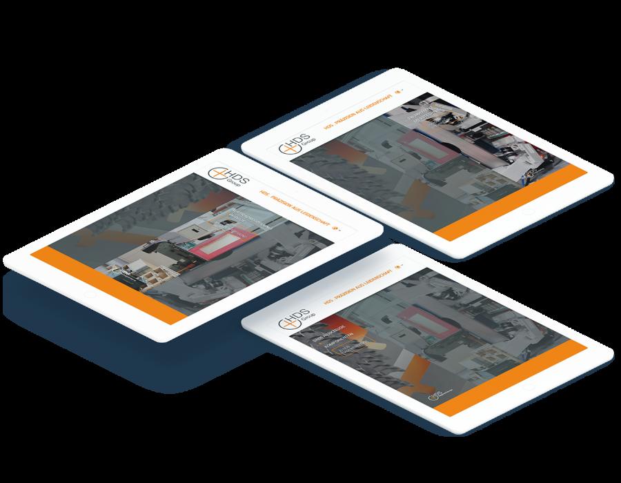 Drei Tablets zeigen verschiedene Seiten der HDS-Group Website
